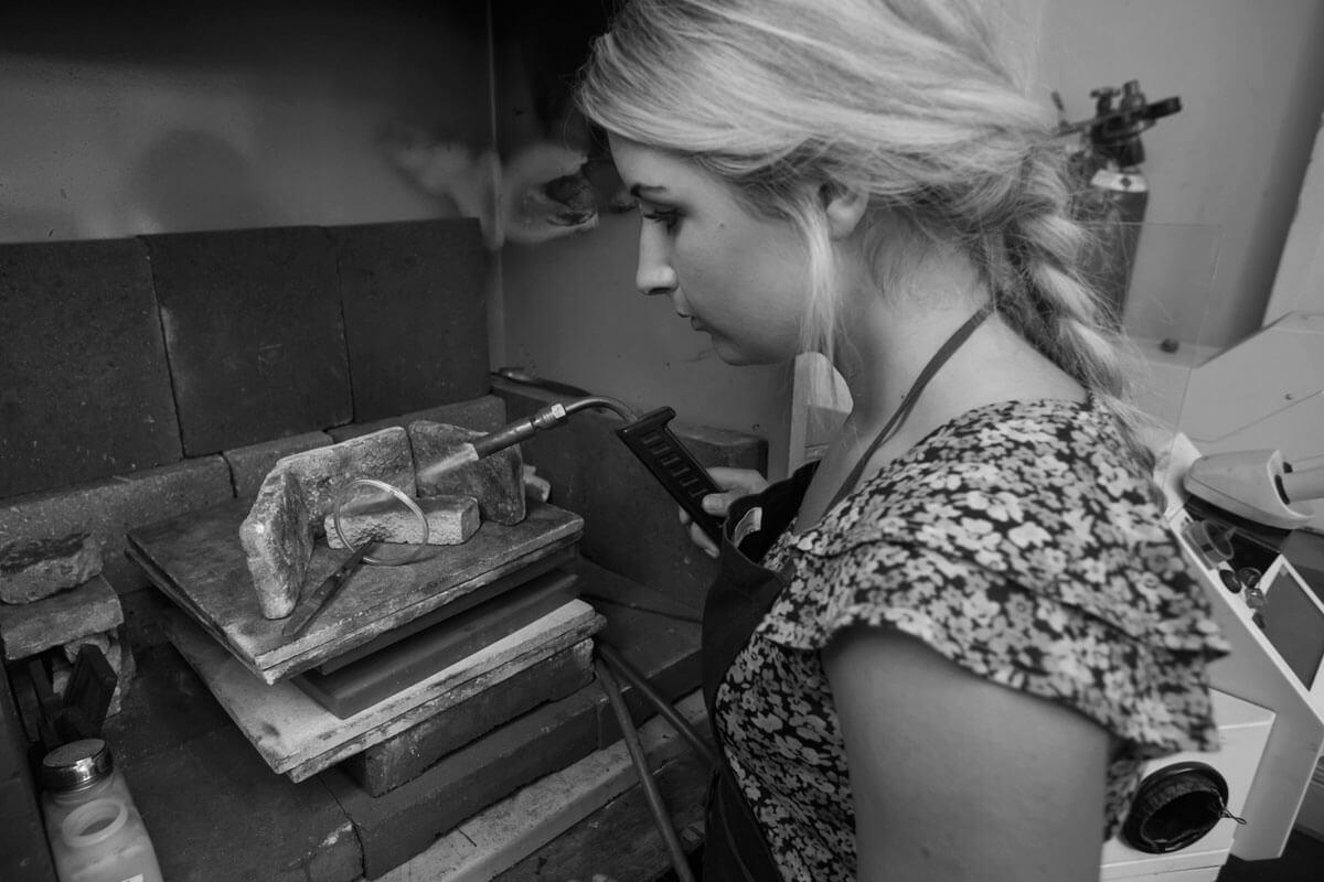 Faller goldsmiths at work, Faller the Jeweller, Derry/ Londonderry , Kimberley soldering a bangle